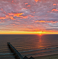 Sunrise At Saltburn Pier And Seafront Portrait by Gary Eason