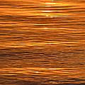 Sunrise On Orange Waves  by Lyle Crump