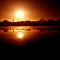 Sunrise Over The Lake by John Henkel