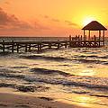 Sunrise Pier by Roupen  Baker