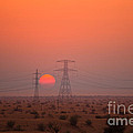 Sunset On Pylons In Dubai Desert by Fototrav Print