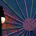 sunset on the Ferris wheel by Chuck  Hicks