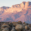 Sunset On The Guadalupe Mountains by Tom Bol