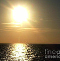 Sunset Over The Ocean by Anita Lewis