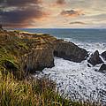 Sunset Over The Oregon Coast by Debra and Dave Vanderlaan