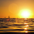 Sunset Over The Water In Waikiki by Elyse Butler