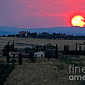 Sunset Over Tuscany In Italy by Tim Holt