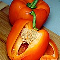 Sweet Orange Peppers On Bamboo Cutting Board by Barbara Griffin