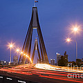Sydney Traffic And Anzac Bridge At Twilight by Colin and Linda McKie
