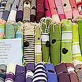Tablecloths For Sale At A Market Stall by Panoramic Images