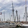Tall Ships Under A Cloudy Sky by Photographic Art by Russel Ray Photos