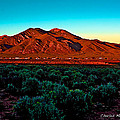 Taos Sunset by Charles Muhle