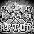 Tattoo Parlor Sign In Rough Neighborhood  by Gary Whitton