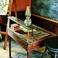 Teacher - Teacher's Desk With Hurricane Lamp by Susan Savad