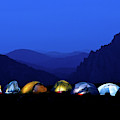 Tents Illuminated Near Mountains by Celin Serbo
