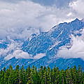 Teton Peaks Through Clouds In Grand Teton National Park-wyoming   by Ruth Hager