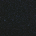 The Big Dipper And Comet Catalina by Lorand Fenyes