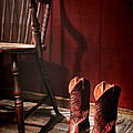 The Cowgirl Boots And The Old Chair by Olivier Le Queinec
