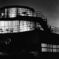 The Exterior Of A Spiral House Design At Night by Eugene Hutchinson