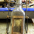 The Face In The Bottle  by Kathy Barney