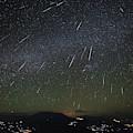 The Geminids Meteor Shower Streaks by Jeff Dai