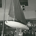 The Girl With A Boat On Her Shoulder. It Weigh Only 40 Les by Retro Images Archive