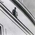 The Man In Love Is Saved From A Parapet by Retro Images Archive