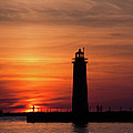 The Muskegon Lighthouse An A Lone Man Fishing by John Harmon