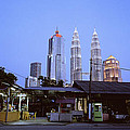 The Petronas Towers At Twilight by Shaun Higson