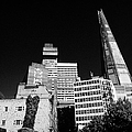 the shard building towering over local buildings including guys hospital in southwark London England by Joe Fox