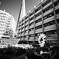 the shard building towering over melior street community garden London England UK by Joe Fox