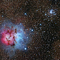 The Trifid Nebula And Messier 21 by Lorand Fenyes