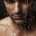 Thoughtful Man Face Under Pouring Water by Oleksiy Maksymenko