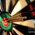 Three Arrows In The Centre Of A Dart Board by Michal Bednarek