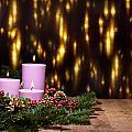 Three Candles In An Advent Flower Arrangement by U Schade