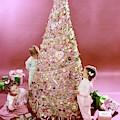 Three Children Eating A Candy Christmas Tree by Herbert Matter