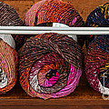 Three Colorful Skeins Of Yarn by Les Palenik