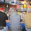 Three Guys In A Bar by Kym Backland