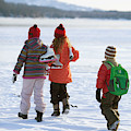 Three Kids Heading Out To Ice Skate by Woods Wheatcroft