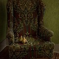 Three Pears Sitting In A Wing Chair by Priska Wettstein