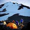 Three People Set Up Camp On Mount Adams by Kirk Mastin