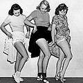 Three Women Lift Their Skirts by Underwood Archives