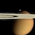 Titan And Saturn's Rings by Nasa/jpl/space Science Institute