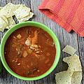 Tortilla Soup With Chips And Fresh Lime On Rustic Wood Backgroun by Brandon Bourdages