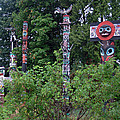 Totem Poles In Stanley Park by Gerry Bates