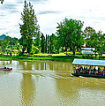 Tourist Raft Being Towed On River Kwai In Kanchanaburi-thailand by Ruth Hager