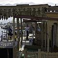 Tourists At The Front Section Of Houseboats Lined Up Along Dal Lake by Ashish Agarwal