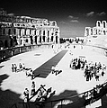 Tourists On The Arena Floor Of The Old Roman Colloseum At El Jem Tunisia Vertical by Joe Fox