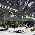 Tourists Surrounded By Snow And Ice Outside One Of The Few Buildings by Ashish Agarwal