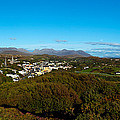 Town On A Hill With 12 Pin Mountain by Panoramic Images
